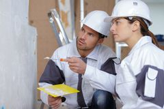 Portrait plasterers team performing wall renovation Royalty Free Stock Photo