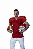 Portrait of player holding rugby ball and helmet Royalty Free Stock Photography