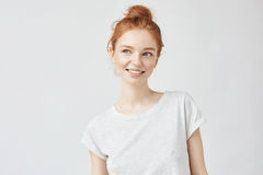 Portrait of playful beautiful ginger girl with freckles smiling. Royalty Free Stock Photography