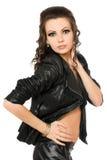 Portrait of playful brunette in black clothes Stock Images