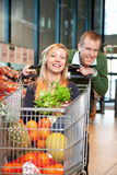 Portrait of playful couple in shopping store Stock Photo
