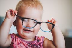 Portrait of playful cute little baby girl stock images