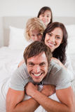 Portrait of a playful family lying on each other Royalty Free Stock Photo