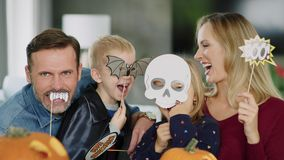 Portrait of family during Halloween. Portrait of playful family with masks during halloween stock footage