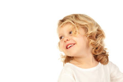 Portrait of playful small kid with long blond hair looking back Stock Photography