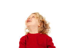 Portrait of playful small kid with long blond hair looking up Royalty Free Stock Photo