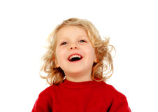 Portrait of playful small kid with long blond hair looking up Stock Photo