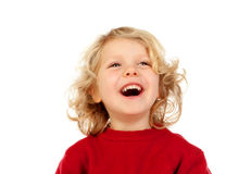 Portrait of playful small kid with long blond hair looking up Stock Image