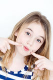 Portrait of playing girl eleven years old. With big eyes and says quiet royalty free stock images