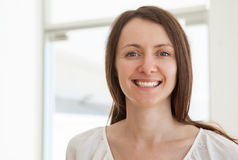 Portrait of a pleasant smiling young woman Stock Image
