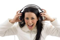 Portrait of pleased woman holding headphone Stock Images