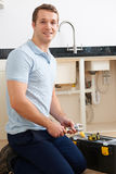 Portrait Of Plumber Fixing Sink stock images