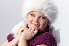 Portrait of plump woman in white fur hat stock photography