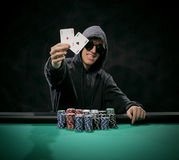 Portrait of a poker player Stock Photos