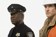 Portrait of a police officer and a construction worker Stock Image