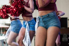 Portrait of pompom girls dancing at Fun car show event. Mulhouse - France - 9 June 2019 - portrait of pompom girls dancing at Fun car show event royalty free stock photography