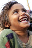 Portrait of a poor little smiling girl. Wow moment. Stock Images