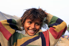 Portrait of a poor little smiling girl. Wow moment. Stock Photography