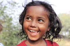 Portrait of a poor little smiling girl. Wow moment. Royalty Free Stock Image