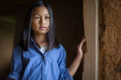 Portrait of a poor little thailand girl lost in deep thoughts, royalty free stock photo