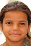 Portrait of poor village girl Stock Image