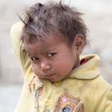 Portrait poor young boy in India. LEH, INDIA - JUNE 29, 2015: Unidentified poor Indian beggar boy on street in Ladakh. Children of the early ages are often Stock Photography