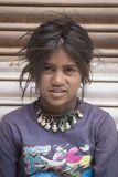 Portrait poor young girl in India. LEH, INDIA - JUNE 29, 2015: Unidentified poor Indian beggar girls on street in Ladakh. Children of the early ages are often stock photo