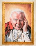 Portrait of Pop Giovanni Paolo II in a gold frame Stock Photography