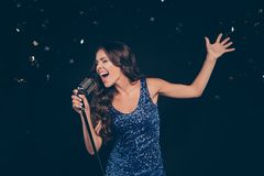 Portrait of popular diva star on scene nice cheerful positive sl. Im graceful adorable charming attractive funny wavy-haired lady singing loudly having fun royalty free stock images