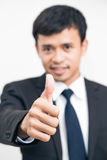 Portrait of Positive Asian Business Man Gesturing Ok Sign On Whi Royalty Free Stock Photo