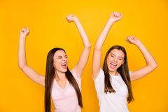 Portrait of positive attractive beautiful people ladies have trip luck lucky achieve goals isolated close eyes scream. Shout yeah raise fists hands wear pastel stock photos