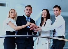 Portrait of positive business group standing on stairs of modern building. Stock Photography