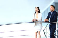 Portrait of positive business group standing on stairs. Of modern office Royalty Free Stock Photos