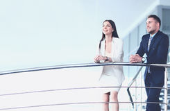 Portrait of positive business group standing on stairs. Of modern office Stock Photo