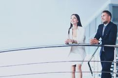 Portrait of positive business group standing on stairs Royalty Free Stock Images
