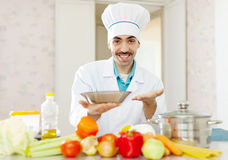 Portrait of positive caucasian male cook Royalty Free Stock Image