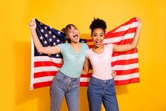 Portrait positive cheerful content joy lady hold hand citizen citizenship liberty patriot beautiful wavy curly top-knot. Bun trendy style stylish t-shirt jeans royalty free stock photo