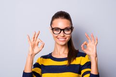 Portrait of positive cheerful content lady youth advertise adverts choice decide feedback recommend tips done great. Attention stylish modern woolen striped royalty free stock photos