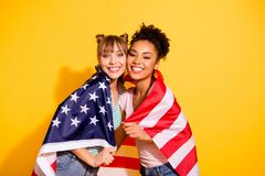 Portrait positive cheerful content millennial cover flag national july liberty patriot beautiful wavy curly top knot bun. Trendy stylish t-shirt jeans trip royalty free stock photo