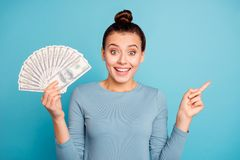 Portrait positive cheerful content student top-knot astonished impressed news wow omg unbelievable isolated blue royalty free stock images