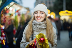 Portrait of positive cheerful smiling woman at Christmas fair Stock Image