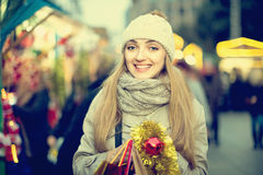 Portrait of positive cheerful smiling woman at Christmas fair Royalty Free Stock Photos