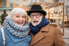 Joyful senior man and woman having fun in city stock photo