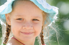 Portrait of positive girl in panama Stock Photography