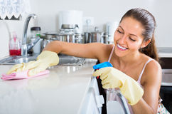 Portrait of positive girl tidying cabinets Stock Photo