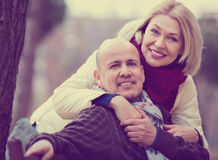 Portrait of positive happy smiling mature couple in city Stock Photography