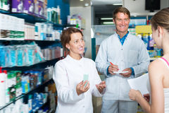 Portrait of positive man and woman pharmacists Stock Images