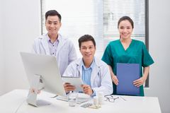 Portrait of positive medical professionals on office and looking at camera stock photo