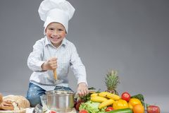 Portrait of Positive Smiling Caucasian Boy Working With Kitchen Royalty Free Stock Photo