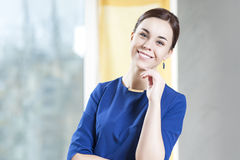 Portrait of Positive Smiling Caucasian Brunette Woman In Stylish Dress Stock Image